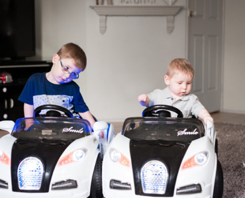 big brother watchs as little brother pulls wing mirrors off ride