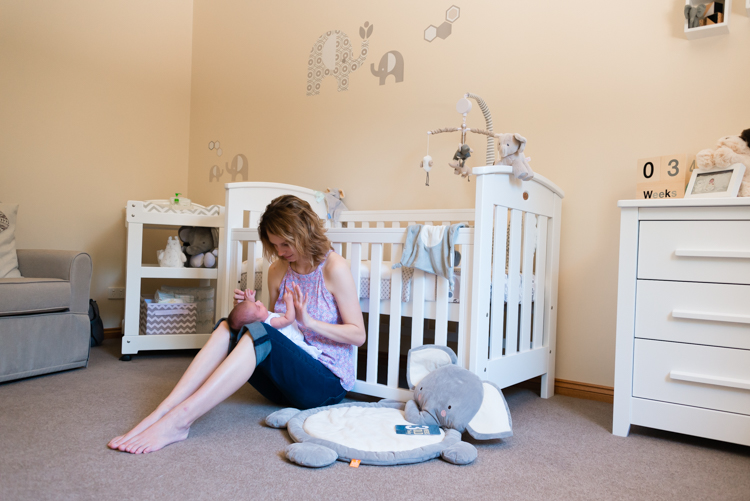 newborn looking up at mother in nursery