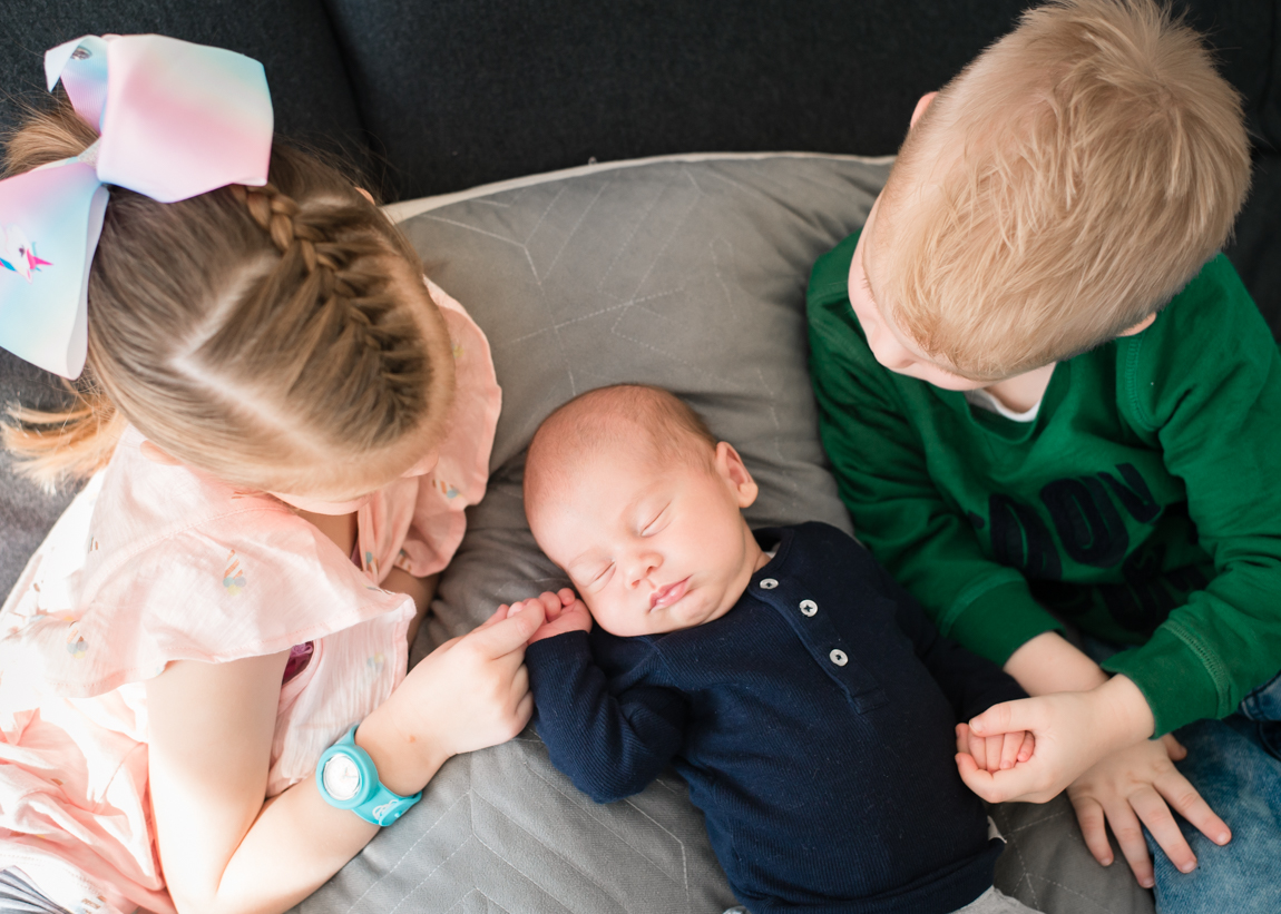 brother and sister with new baby